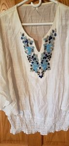 White blouse with blue embellishment
